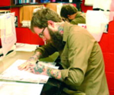 Tattoo+drawing+Heath+Leffel%2C+tattoo+artist+at+Electric+Tattoo%2C+works+on+a+drawing+to+be+used+on+a+client.+%22You+should+be+nervous%2C%22+he+said+about+making+the+choice+to+get+a+tattoo.+Pictured+at+left+from+left+are+Ben+Siebert%2C+Leffel%2C+Marilyn+Wathke%2C+Kevin+Wathke+and+Dominic+Krumpe.%0A