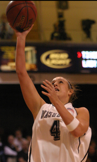 Junior+forward+Amanda+Holmes+goes+for+the+lay-up+against+Ft.+Hays+State.%0A