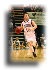 Reed Hein, junior guard, drives the ball down the court in Saturday's game against Truman in Lee Arena.
