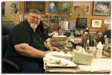 Art+therapist+and+local+artist+Bob+Ault+sits+at+his+work+table.+Art+can+help+you+find+the+happiness+you+deserve%2C+he+says.%0A