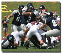 RaShawn Mosley, Washburn running back, tries to break through a tackle during the Ichabods loss to No. 5-ranked Chadron State. Mosely carried 18 times for 81 yards in the game.