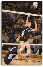 Caitlin+Conley%2C+Washburn+hitter%2C+prepares+to+spike+the+ball+after+a+bump+from+Mandi+Cox%0A