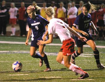 Junior Forward Danielle Ayala moves the ball against Central Missouri's defense Saturday night. The Lady Blues finished off Homecoming night with a win, providing the clean sweep in all Washburn sports Saturday.