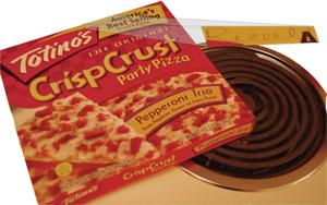 Freezer+foe+Nov.+1%2C+nearly+5+million+Totino%27s+and+Jeno%27s+brand+frozen+pizzas+were+recalled+by+parent+company+General+Mills+because+of+possible+E.+coli+contaminations.+However%2C+the+above+pizza+was+purchased+last+week+by+Review+photographer+Kathryn+Ellis+at+the+Price+Chopper%2C+4015+SW+10th+Ave.%2C+with+the+word+%22recall%22+written+on+the+box.%0A