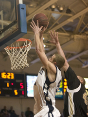 Snyders+special+Washburn+forward+Kyle+Snyder+puts+in+two+of+his+15+points+Saturday+night+against+Emporia+State.+Snyder+pulled+a+double-double+with+15+points+and+10+rebounds.%0A