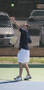 Service slam Senior Nathan Martin practices his serve on Washburn's tennis courts. Martin lost in the third round of the 2007 ITA North Central Regional Tournament last semester 6-1, 6-1 to Nebraska-Kearney's William Jacome.