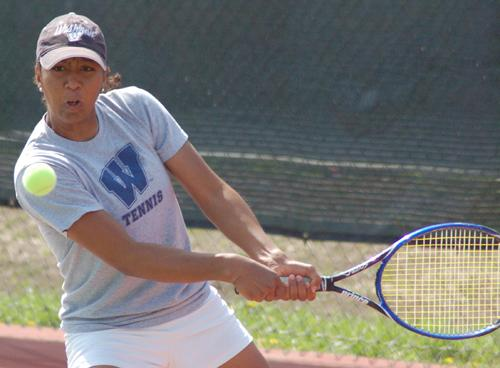 Golden Blue Senior Diana Goldsmith backhands a return Saturday at the MIAA Championships. Goldsmith won her No. 1 singles match 6-0, 6-3 against Northwest Missouris Kristina Vucenov but her team fell to the Bearcats 5-3 in the semifinals
