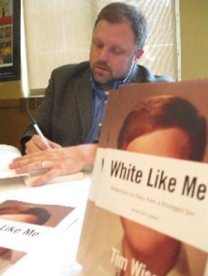 Author sees racism in presidential race