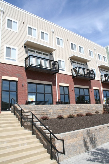 Spacious More than a year after opening its doors to new residents, College Hill Apartments has secured its first new retailer, Submarina California Subs. It is also suing the only current business located in the area, Jerry's Bike Shop.