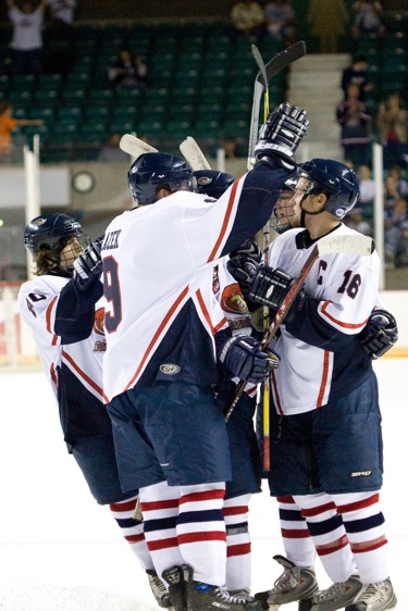 Forward+Andrew+Blazek+and+team+captain+Matt+Hartmann+celebrate+one+of+the+RoadRunners%27+four+goals+in+a+win+against+Springfield.%0A