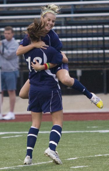 Jessica Mainz, No. 13, and Danielle Ayala celebrate a goal against UNO.