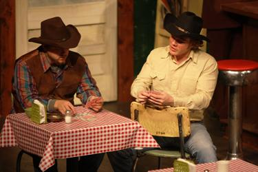Cowboys Bo Decker (Matthew Steiner) and Virgil (Michaul Garbo) play a heated game of poker at the bus stop. Decker owns a Montana ranch and is looking for love in all the wrong places.