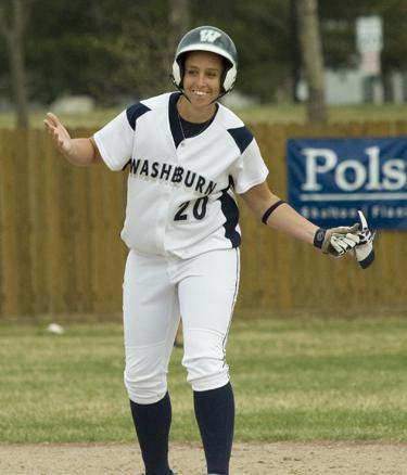 Senior first baseman Dani White reacts after hitting a double. White was a first team MIAA selection for the second consecutive season.