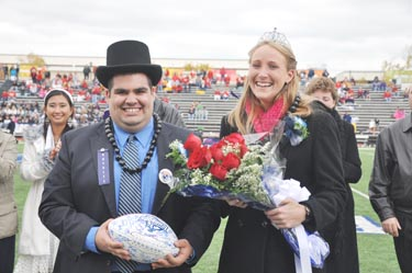 Real+Life+Royalty+Romero+and+Perkuhn+receive+their+crowns+as+King+and+Queen+during+half-time+of+Saturday%E2%80%99s+football+game+against+Emporia.+Both+are+actively+involved+on+campus+and+were+excited+to+receive+their+titles.%0A