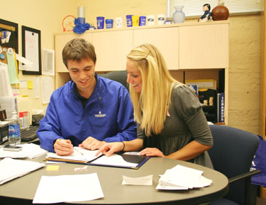 Work it Garrett Love and Caley Onek work on a Success Week proposal. The policy was proposed to Academic Affairs on the 26th. Photo by Matt Wilper.