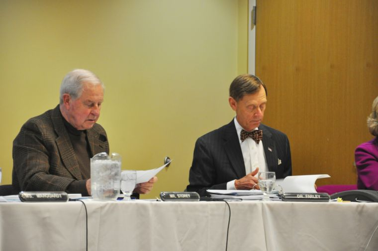 Budget Dilemmas Board member Bob Storey and University President Jerry Farley review paperwork at the Jan. 29 Board of Regents meeting. After discussing the possibility of outsourcing facility services, the Board received criticism from former employee Mary Lou Herring who suggested an audit of administrative salaries as a means to cut expenses.