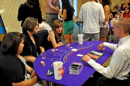 Going+All+In+Student+Orientation+Counselor+Joe+Muiller+deals+a+game+of+blackjack+to+students+at+his+table.+Students+of+all+experience+were+encouraged+to+partake+in+the+festivities.%0A