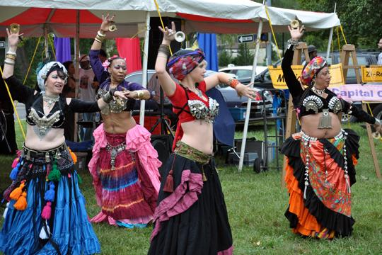 Belly dancers at the Aaron Douglas Art Fair show their brilliant finery as they dance and chime their finger cymbals. The fair had varied entertainment, and afforder Washburn art students lots of opportunities for volunteer experiences within their field