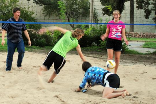 Fellowship in action Kyle Volle and Grace Hildebrand watch as their opponents scramble for the ball on the new sand volleyball court outside the Ichtus house. The house was remodeled for the Designer's Showcase last semester.
