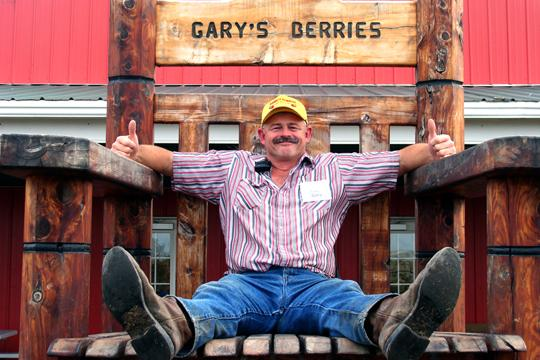 Siting+Pretty+Gary+Star%2C+owner+of+Garry%E2%80%99s+Berries%2C+shows+off+one+of+his+many+props.+The+annual+Fall+Festival+includes+a+corn+maze%2C+pumpkin+patch%2C+haunted+house+and+several+other+activities.%0A