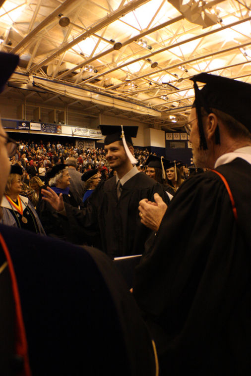 Students participate in the tradition of recessional aftering having been awarded their degrees. Washburn had 395 students graduate this fall.