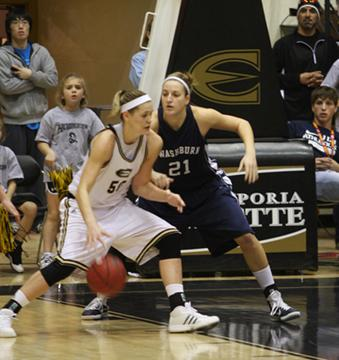 Alli Volkens, left and Cassie Lombardino battle in the post during Saturday's edition of the Turnpike Tussle. Lombardino led Washburn to the win 66-62