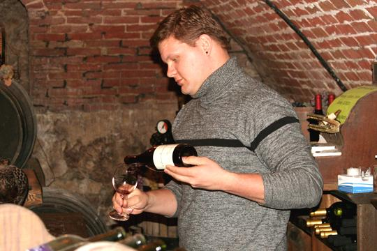 A+taste+of+Kansas+Josh+Bryant+pours+a+glass+in+the+wine+cellar+of+Matrot+Castle.+The+Topeka+castle+houses+a+winery+and+offers+100+percent+Kansas+wine.%0A