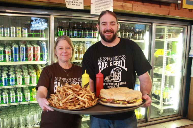 Sharing the love Debbie Maichel, owner of Speck's Bar and Grill has carried on her father's legacy since his passing in February, 1988. Speck's is a Topeka original and home of the three pound burger. Only one person has been able to complete the burger challenge since its indtroduction in 1990.