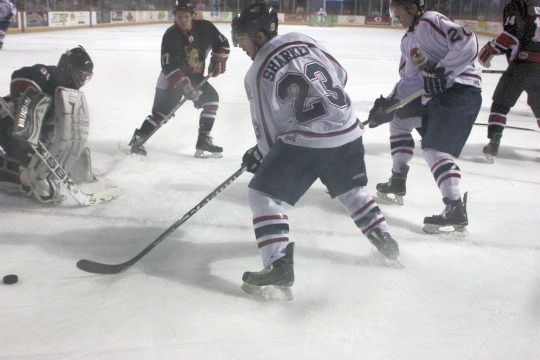 Kyle Sharkey grabs a loose puck as he tries to get a shot past Matt Green during a regular season game between Topeka and Wichita Falls. The two teams battle tonight at 7 05 p.m.