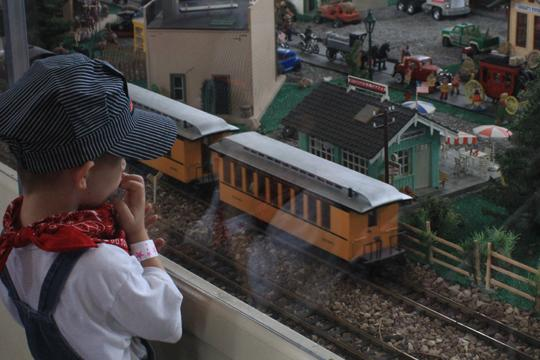 All+Aboard+A+young+kid+stops+to+observe+a+model+train+as+it+passes+by+at+The+Great+Overland+Station%27s+fourth+annual+Railroad+Festival+on+August+20%2C+2011%0A