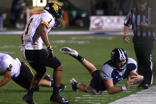 Ichabods Rolling Dane Simoneau dives for a gain in Washburn's last home game. The Ichabods went on the road for a win last weekend 42-14.