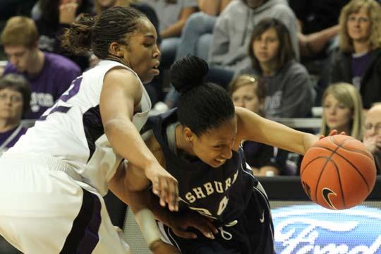 Just a bit short Washburn senior guard Ebonie williams runs outside an opposing Kansas State Wildcat. The Lady Blues held their own but ultimately lost 52-50. They play next Nov. 14 versus Tabor College.