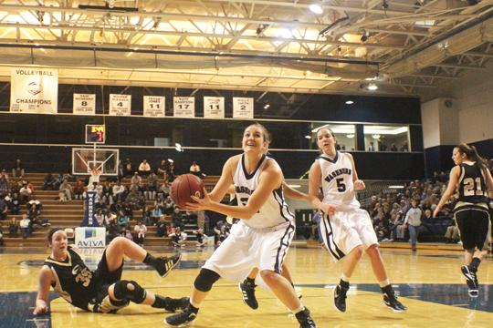 Junior forward Dana Elliot looks to score against Emporia State during a regular season game. Elliot led the Lady Blues with 18 points against West Texas A&M University in the first round of the NCAA Playoffs. Washburn won 68-36 and will wait to see who they play next.