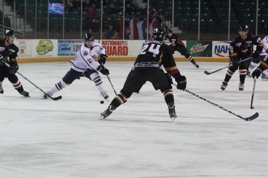 Look+at+me+now+Topeka+forward+Ryan+White+%2812%29+skates+through+defenders+on+Thursday+night.+White+had+a+hat+trick+in+the+contest%2C+as+he+helped+lead+Topeka+to+a+8-2+throttling+of+the+Corpus+Christi+Ice+Rays.%0A