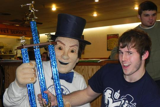 "Win-Win Derek Fritz, a student of the winning bowling team, hoists the trophy with the Washburn Ichabod at the ""Bowl For Kids Sake"" fundraiser at Gage Bowl. Washburn student organizations formed 19 teams to compete in the tournament. With the $50 entry fee for each team plus on site donations, more than $2,000 was raised for The Big Brothers Big Sisters of Topeka."