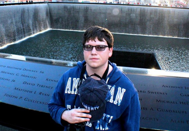 Remembering+Brian+Dulle+stands+in+front+of+the+9%2F11+Memorial+in+New+York+City%2C+respectfully+putting+his+hat+over+his+heart%2C+remembering+the+hundreds+of+lives+lost+on+that+day.%0A