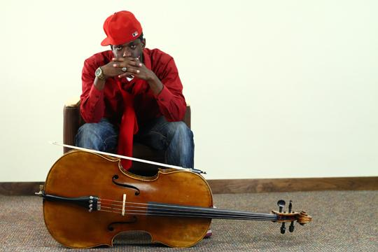 Cello+There+Phillip+Watson+poses+for+the+Washburn+Review+with+his+cello.+Watson+also+goes+by+the+name+%22Brail.%22%0A