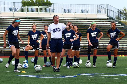 Kicking+Off+the+Season+Tim+Collins%2C+Lady+Blues+soccer+head+coach%2C+talks+to+his+team+during+a+drill+at+practice.+Collins+is+hoping+to+build+off+of+his+team%E2%80%99s+perserverance+last+season.%0A