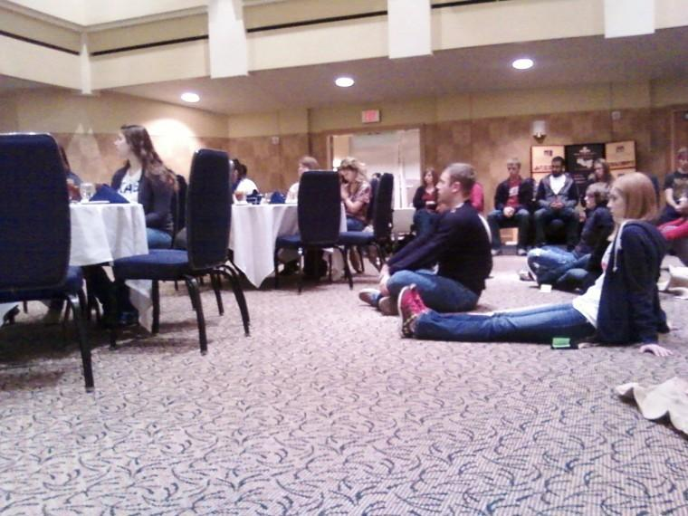 Audience members sit last week and listen to a presentation during the Oxfam Hunger Banquet at Washburn. The goal of the event was to introduce individuals to poverty and social class stereotypes.