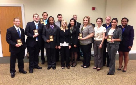 Washburn's Mock Trial students pose for a photo with their awards Oct. 20, 2012. Their competition took place at Northwest Missouri State, but the team travels across the country to compete.