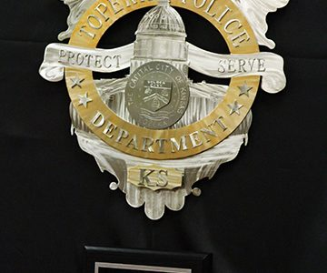 Renee Johnson's police badge donated to the Topeka Police Department commemorates the fallen officers. Johnson wishes that every person in service could have their own badge.