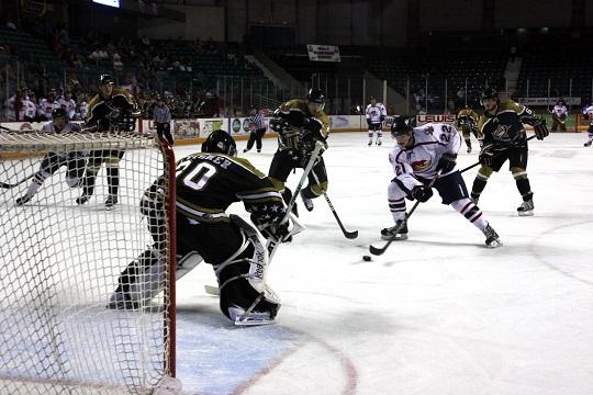 Mike Covach (22) looks to get a shot past goaltender Hunter Leisner in the second period Sunday night. Covach couldn't score on the play, as Topeka fell 2-1 and fell behind 2-0 in the best-of-five series.