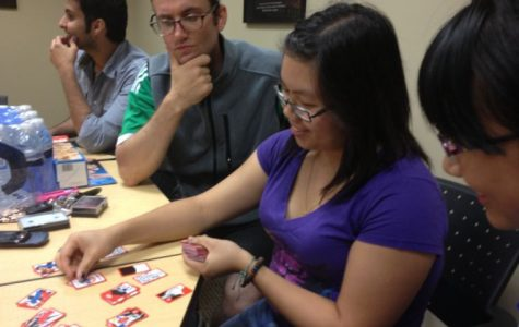 Andy Vogel, a liberal studies grad student, and Teresa Chiu, a senior majoring in biology and chemistry, play the Korean card game, Stop-Go. The game itself is being played with Japanese hanafuda cards.
