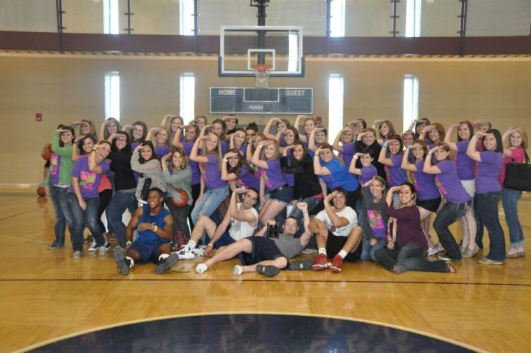 Participants and Delta Gamma Fraternity throw up the sailor salute after Anchor Slam. Anchor Slam is a basketball tournament thrown by the Delta Gammas for their philanthropy, Service for Sight.
