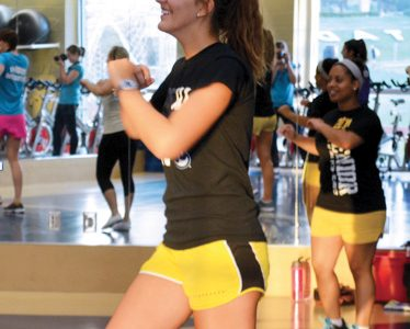Students have fun while participating in a Zumba dance routine. Zumba is offered Wednesdays from 12:10-12:45 p.m. and Fridays from 5:10-6:10 p.m.