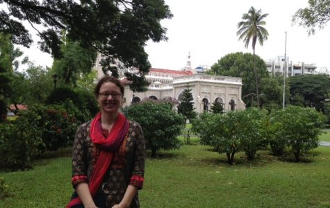 Professor Tonya Kowalski stands in front of Aga Kahn Palace in Pune, India.