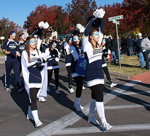 Washburn cheerleaders march during the Homecoming parade.