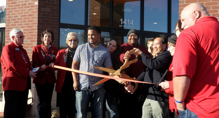 James Weckerling, proud new owner of Boca Café, cuts the ceremonial ribbon, officially reopening the restaurant for business.Boca Café's new management is still dedicated to serving high quality food and hope to add more international food to their menu.