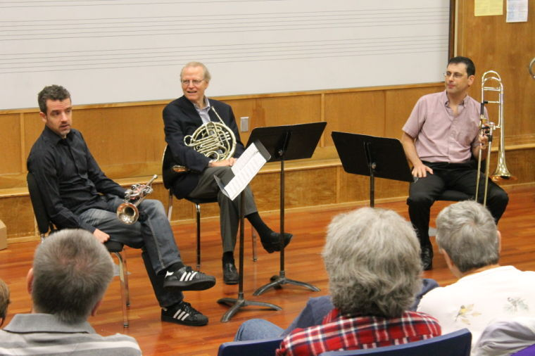 Trumpet player, Joe Brugstaller, French Hornist David Jolley, and Trombonist Haim Avitsur give advice and play for Washburn students and members of the public Monday morning in the Washburn choral room.