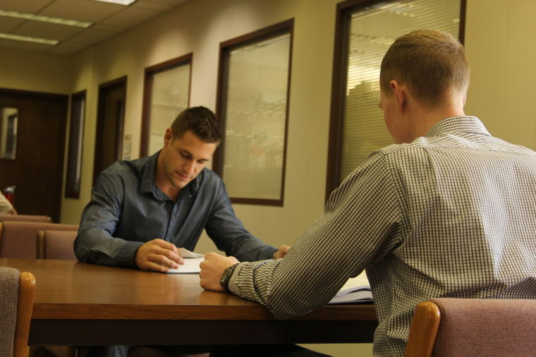 Law school requires much research, reading and writing. First year Washburn law students Marty Pfannenstiel and Bobby Chipman credit sports training for helping them learn the time and stress management skills essential for intense study.